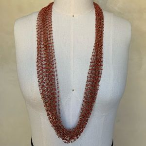 Jewelry - Rope necklace with red bead and brass